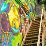 Street art in Valaparaiso, Chile. Cat on colourful staircase.