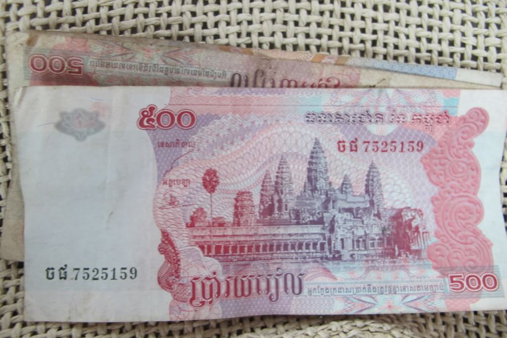 Local Cambodian Riel currency with Angkor Wat