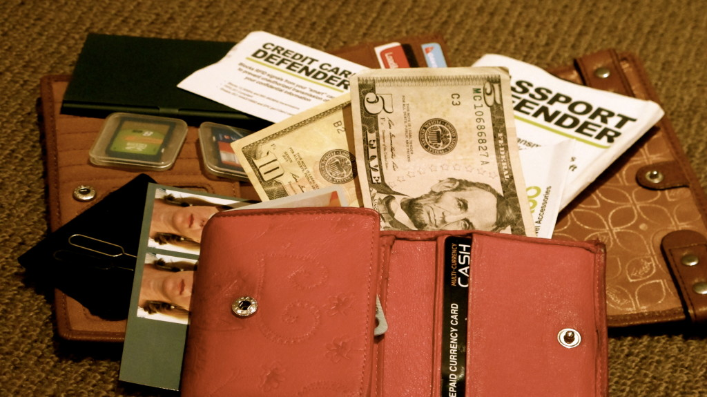 Take two wallets and separate your cash, cards, passport and memory cards